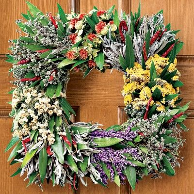 Square Mixed-Herb Wreath #williamssonoma -Cooks and gardeners will delight in this fragrant wreath of culinary herbs and other air-dried botanicals in a distinctive square shape. Scarlet dried chiles de arbol are arranged with painterly skill, interspersed with fresh bay leaves, dried marjoram, purple Mexican sage, double feverfew, orange safflower and yarrow.