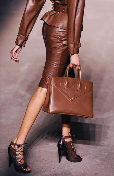 Hermes. Love how the accessories match ... shoes, skirt, jacket, and belt. Very stylish.