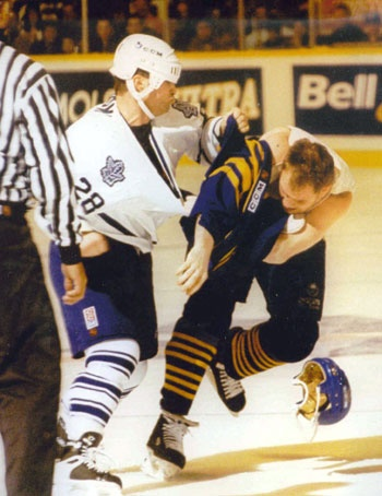Tie rips off his opponent's jersey during a fight.