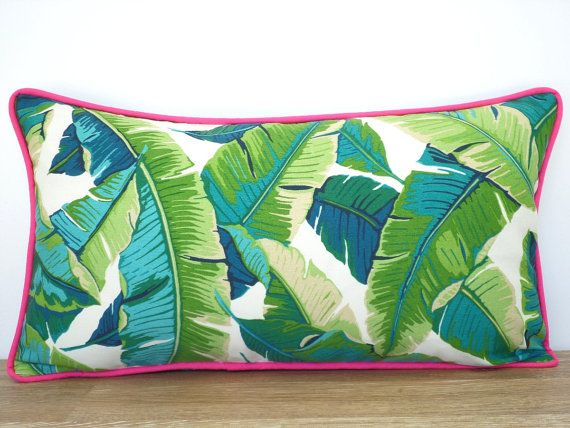 This tropical pillow cover comes in an indoor/outdoor fabric and is water and stain resistant. Colors include teal, green, turquoise and cream and