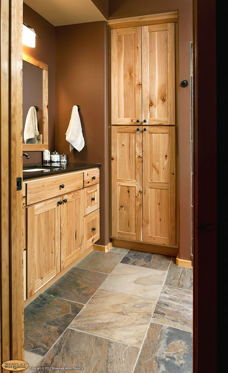 rustic hickory bathroom vanity | Cabinets: Rustic hickory appears again in this lower-level bath