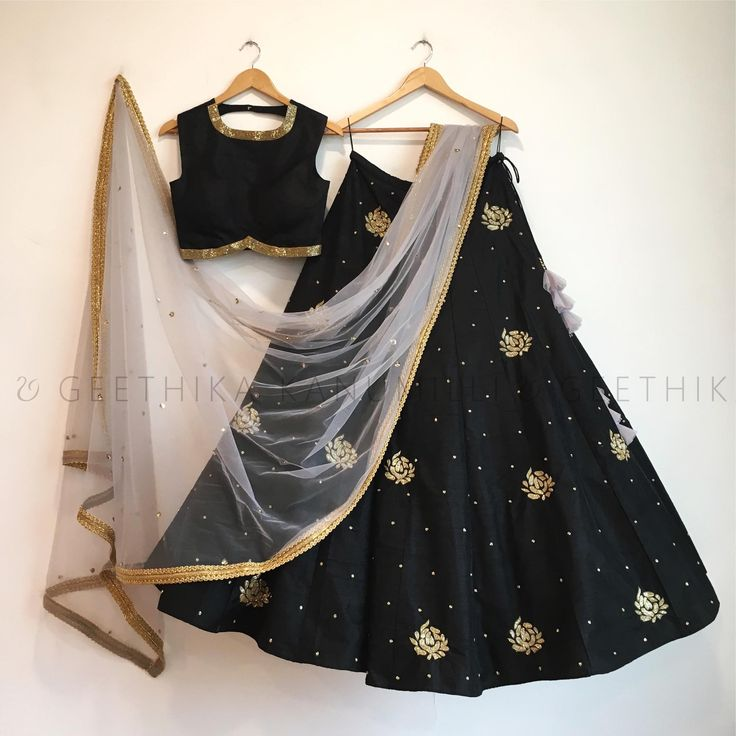 Stunning black color lehenga and crop top with white net duppata. 16 June 2017