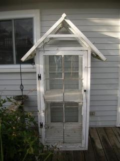 Small greenhouse built from old windows.