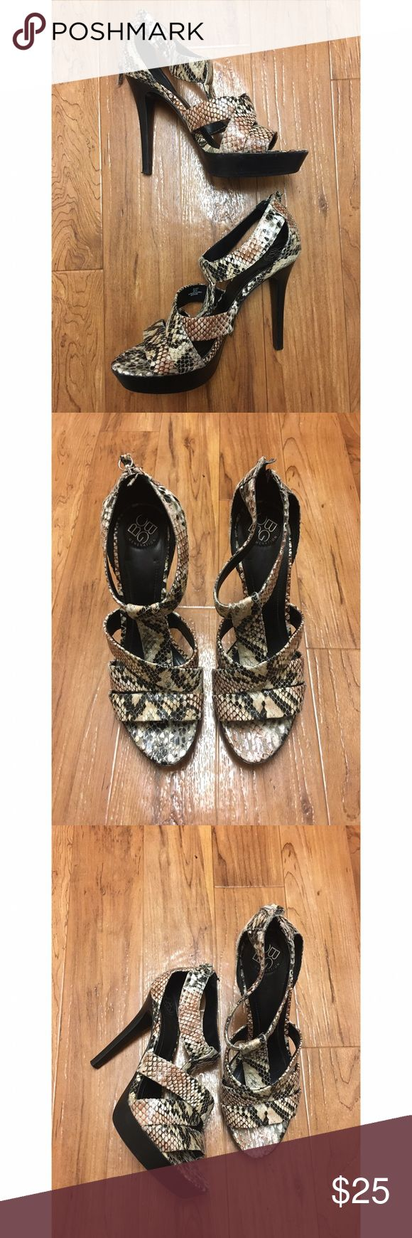 BCBG size 9 snakeskin heels Straps size 9 snakeskin heels by BCBG. Only worn a couple times with no flaws at all! Super cute and comfortable. These lasts the whole night out at the club without your feet killing you at the end of the night. Zips in the back. BCBGeneration Shoes Heels