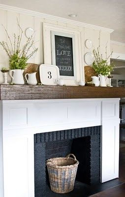 Hahaha!  this encorporates everything!  roughed up wood mantel, white surround (i would distress it) with black bricks.  Not my most favorite