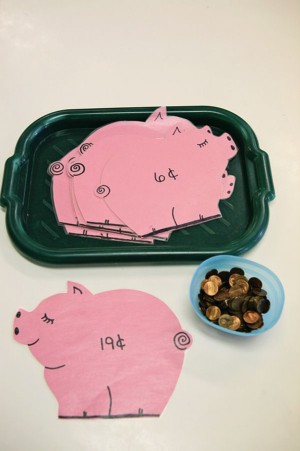 Counting pennies. I cut pigs out of construction paper and laminated. They are labeled with a number and the kids count out pennies onto the piggy banks.