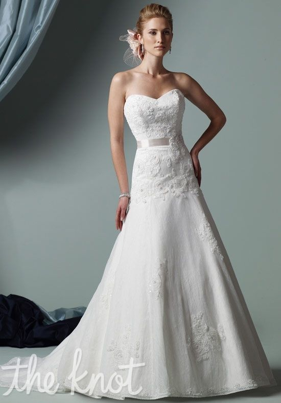 I REALLY love this dress!! I love the detail on the top and then how flows down to organza/chiffon! And of course the sweetheart neck line!