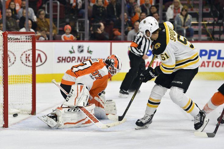 Boston Bruins' Ryan Spooner, right, scores a goal past Philadelphia Flyers' Brian Elliott during the first period of an NHL hockey game, Saturday, Dec. 2, 2017, in Philadelphia. (AP Photo/Derik Hamilton)