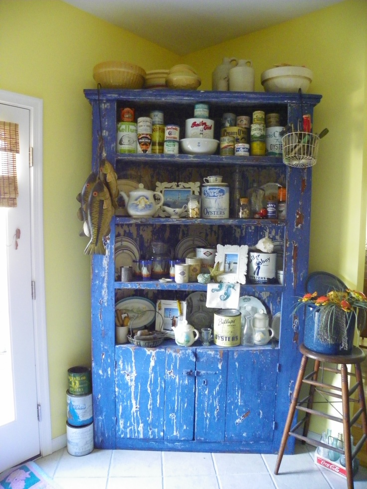 My worn denim blue primitive corner cabinet  a auction find here