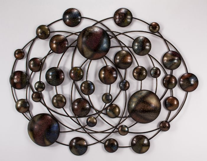 1971-PL.jpg Metal wall art gives purpose and definition to a space. It is like the jewelry in a room. It can dress it up, it can also distract. This one reminded us of the television series Penny Dreadful with the presence of spiderweb like circulating lines and the bulbous forms.