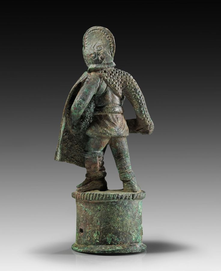 Roman bronze figure of a gladiator (secutor) with shield and sword on cylindrical base. 3rd century A.D. Green patina, intact.