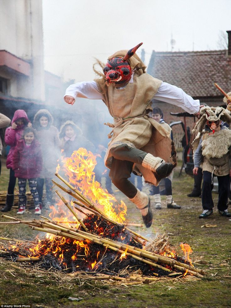 Leap of fire: A participant bravely jumps over a fire during the celebrations, which is said to be an old custom