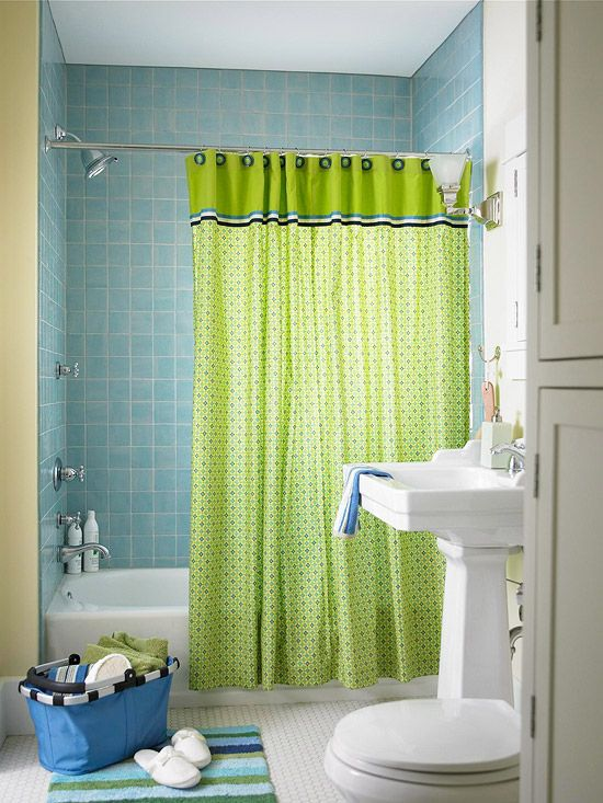 Spring Green + Sky Blue - Fresh and clean, this eclectic bath gets its watery inspiration from an aqua-blue tiled surround and a patterned shower curtain in blue and green. Chrome faucets, white fixtures, woodwork, and hexagonal-tile floor mean the accent hues can be changed out at any time to create a different look.