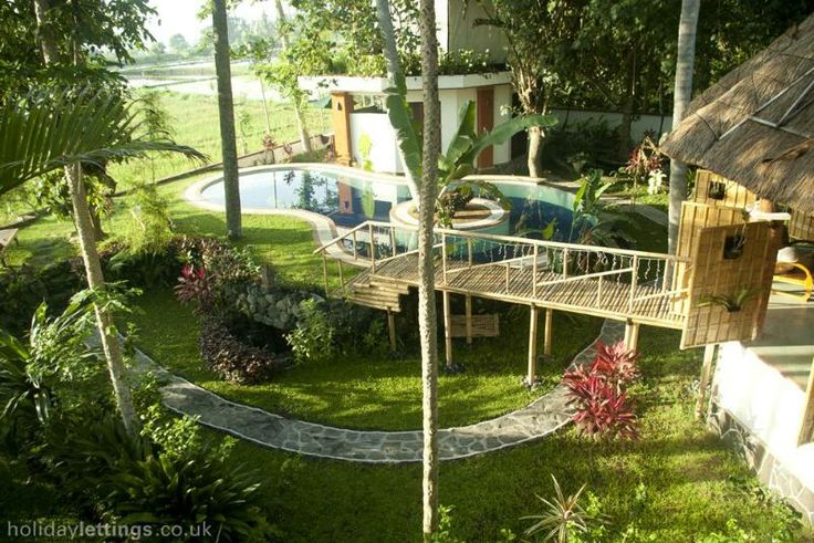 Pavillion living and dining room with bridge to 14 meter pool, bedrooms and rice terraces