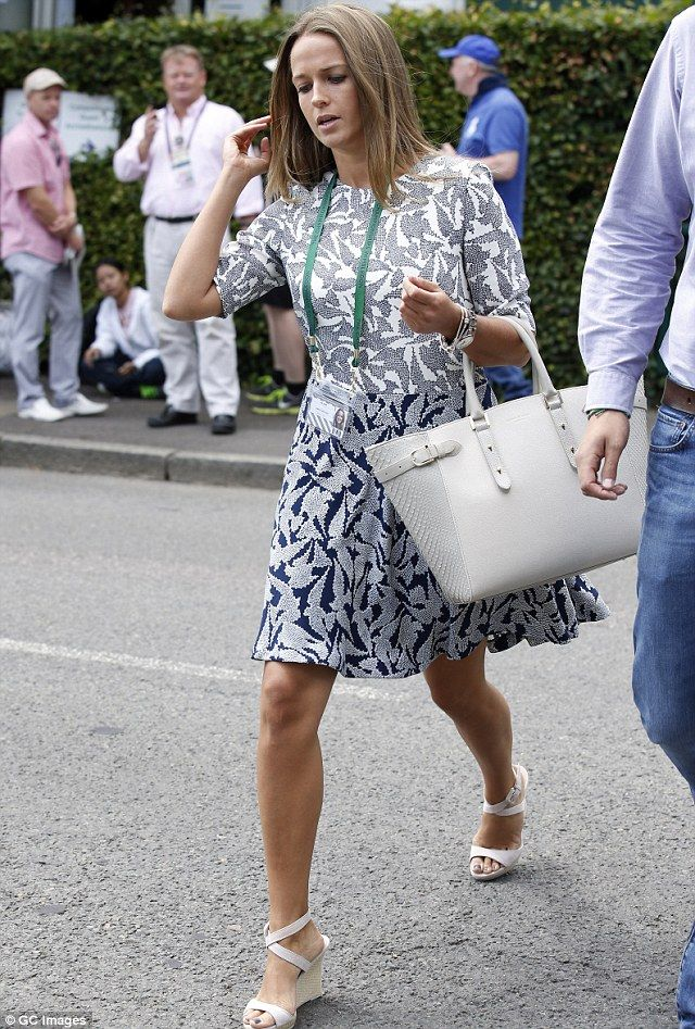 Kim was once again carrying her beloved Marylebone Aspinal cream tote bag and looked quietly confident as she strode into Wimbledon