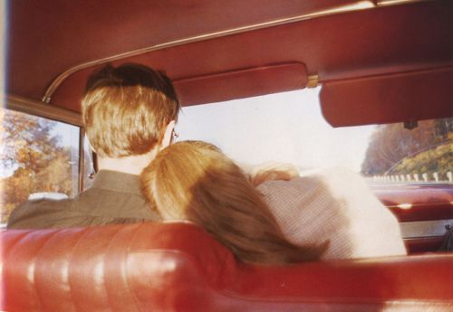 kim and mark in the red car - nan goldin, 1978.