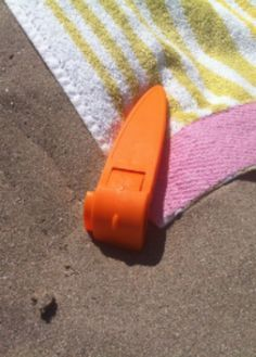 Beach towel stakes: Beats putting your shoes, cooler, purse and whatever else you can find down on the corners of your towel!