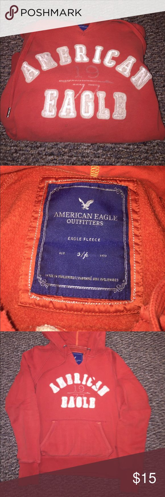 American eagle orange hoodie!! American eagle orange hoodie!! Good Condition !! Worn but no heavy wear or damage. Cut v neck was originally bought this way!! American Eagle Outfitters Tops Sweatshirts & Hoodies