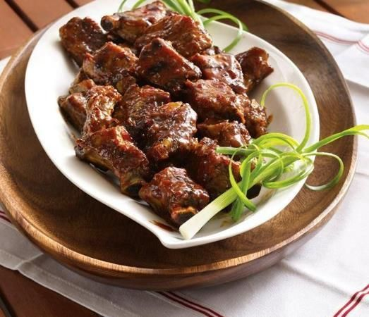 Put your slow cooker to work and prepare tender riblets coated in a sweet-and-spicy glaze.