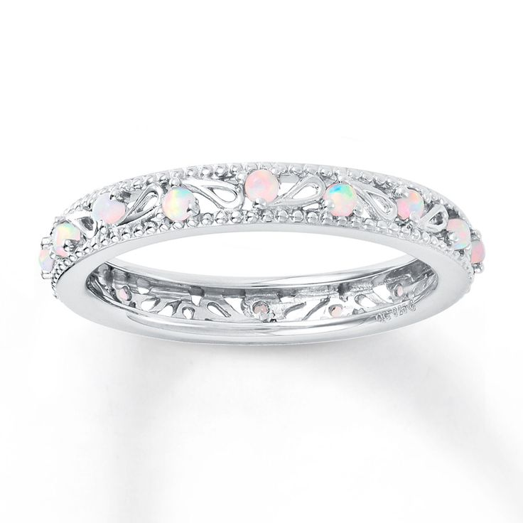 The more and more I see them, I am thinking I want an Opals instead of a Diamond. And I just love this style! - CJ