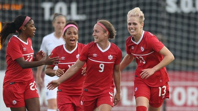 Sophie Schmidt #13 of Canada celebrates her goal with Josee Belanger #9 and Desiree Scott #11 and Ashley Lawrence #22