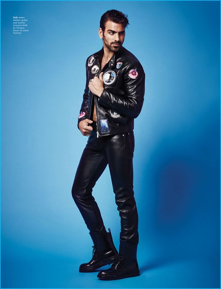 Nyle DiMarco poses in a leather jacket and pants from Versace with Louis Vuitton combat boots for Attitude magazine.