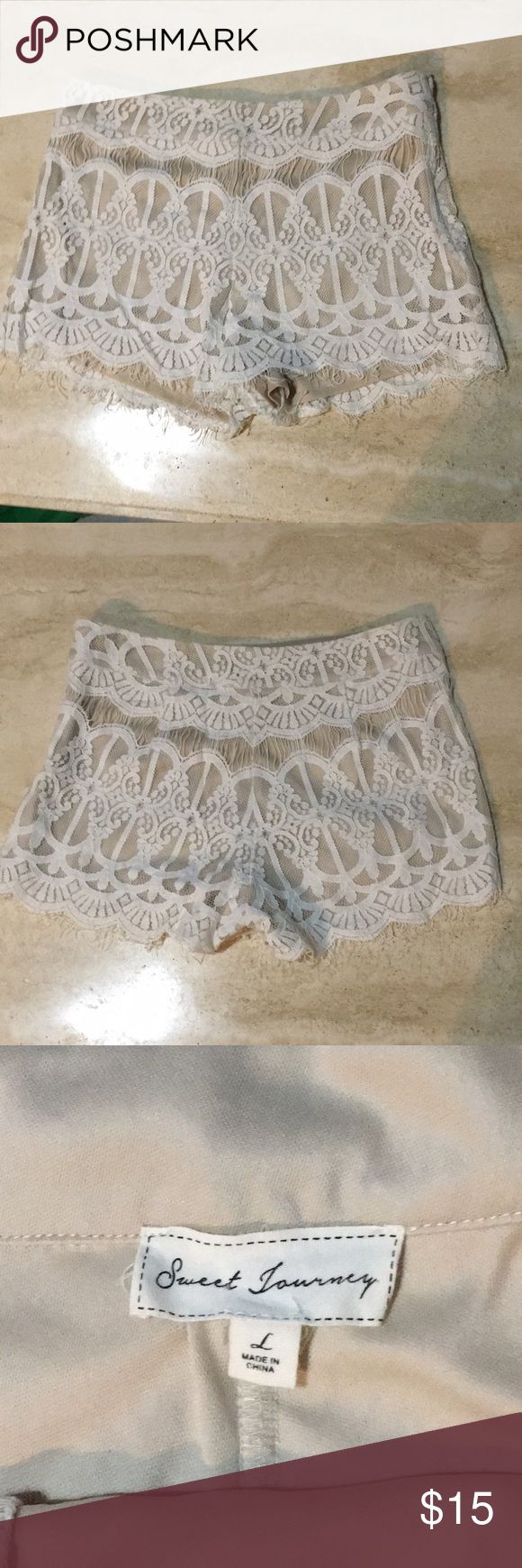 White And Cream Lace Shorts/Size Large These white and cream lace shorts are a cute staple item that every wardrobe needs. There is a zipper on the side. They have only been worn a few times and are in great condition! Let me know if you have any questions! Shorts
