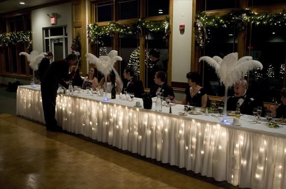 Icicle Lights under a table cloth is a great idea for New Years decor