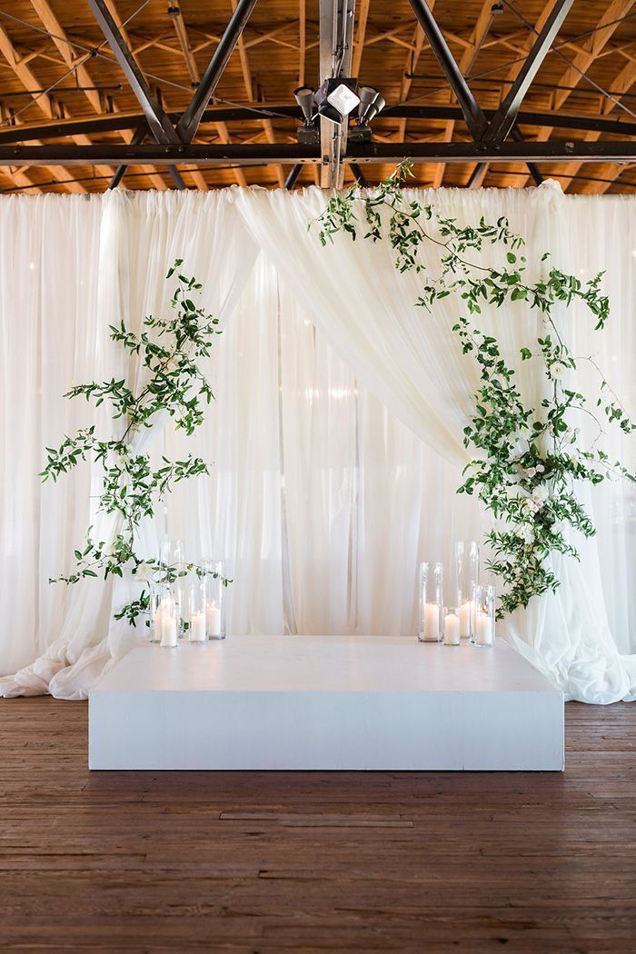 Rustic Draped Wedding Ceremony Backdrop With Modern Greenery And Candles Modern Ceremony Backdrop Wedding Ceremony Decorations Ceremony Backdrop