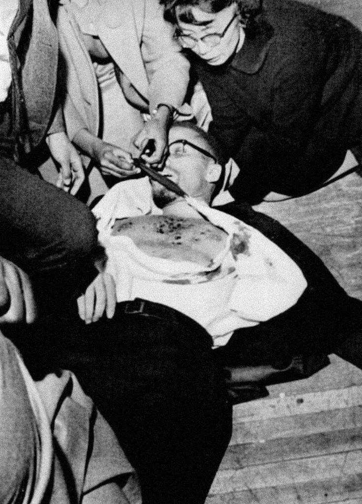 Yuri Kochiyama  kneels over the body of Malcolm X, moments after his assassination. via reddit
