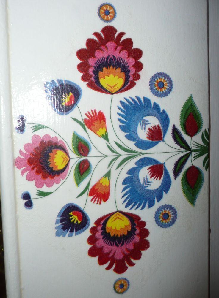 Folk doors - detail. Decoupage technique.  Pattern: Polish paper cutting (Wycinanki) folk art. Łowicz region.