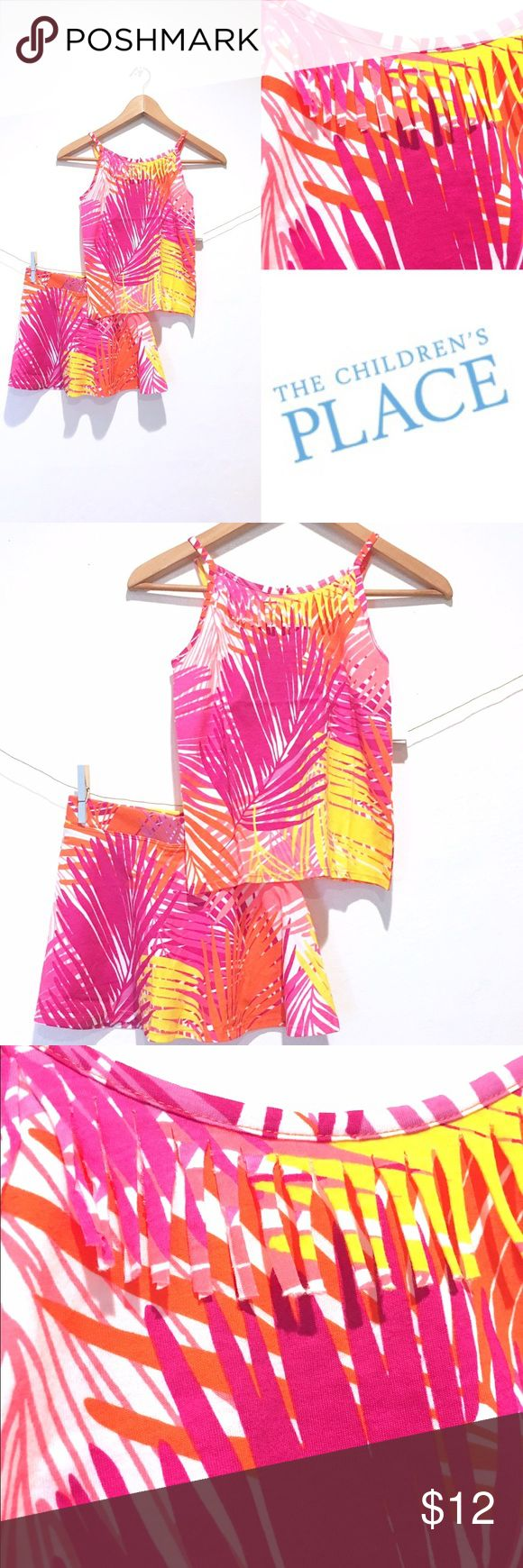 Palm Print Skort & Fringe Tank by Children'a Place Feel the breeze in this tropical matching set! 🌴NWT Size 7/8 🌴Made of 100% cotton 🌴allover palm print in tangelo  🌴Elasticized waist Skort has attached shorts  🌴Spagetti Strap Tank with Fringe Accent  🌴above-the-knee length  🌴Tagless label  🌴Machine Wash Cold Tumble Dry Low The Children's Place Matching Sets