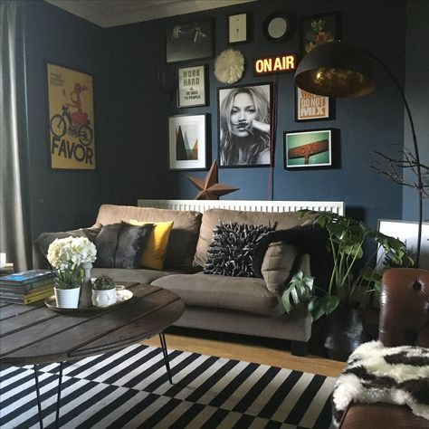 Dark interiors, living room painted in Farrow and Ball Stiffkey Blue with gallery wall and IKEA monochrome rug. Kate Moss poster included.