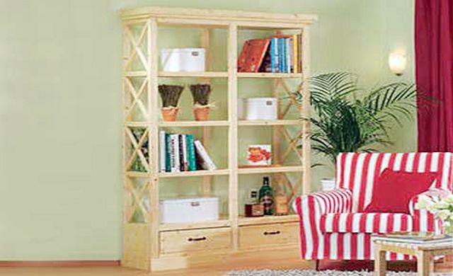 Filigran und zweckmäßig: Dieses Bücherregal bietet Ihren Büchern viel Platz, in den Schubladen ist zudem Stauraum für kleinteilige Erinnerungsstücke