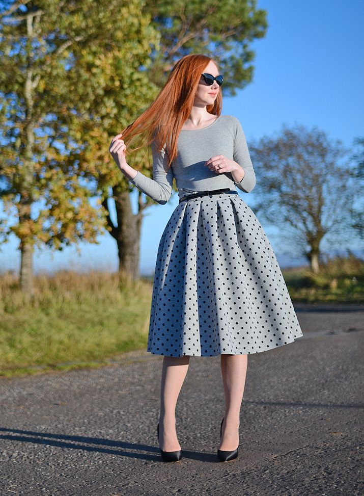 grey polka dot 50s-style skirt with high heels and belt