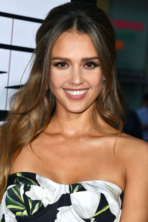 Who: Jessica Alba What: Bardot Hair How-To: At the premiere of Mechanic: Resurrection the actress and mogul gave us full on '60s, tugging her hair up into a soft half updo that was bumped up at the crown. But there's a reason it looked modern: Loose, face-framing pieces pulled out in front. And no, they weren't hit with a curling iron. (That would look too prom.) Editor's Pick: Verb Hydrating Shampoo, $14, sephora.com.