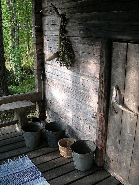 The entrance to the smoke sauna door. The door handle is a moose antler. Note the birch whisk (vihta) hanging on the wall, with which we smote ourselves! In the heat of the sauna, the vihta produces a wonderful herbal smell.
