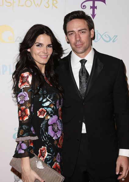 "Angie Harmon Jason Sehorn Photos - Jason Sehorn (R) and Angie Harmon (L) attend Prince's ""The Purple Party"" at The Avalon on February 22, 2009 in Los Angeles, California.  (Photo by Noel Vasquez/Getty Images) * Local Caption * Jason Sehorn;Angie Harmon - Prince's ""The Purple Party"" - Arrivals"