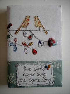 .So pretty....we love birds...we love fabric book cover, perfect!