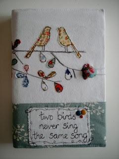 .So pretty....we love birds...we love fabric book cover, perfect!