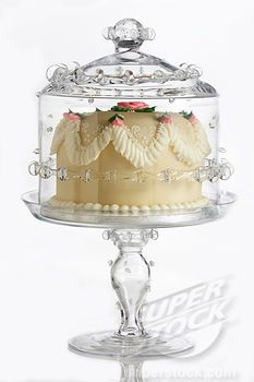 fancy cake on ornate, glass cake plate