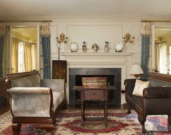 The parlor is centered on an original fireplace mantel.