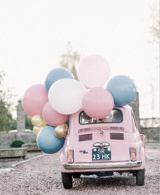 Pink car with lots of white, pink and blue balloons. #summer #pastel