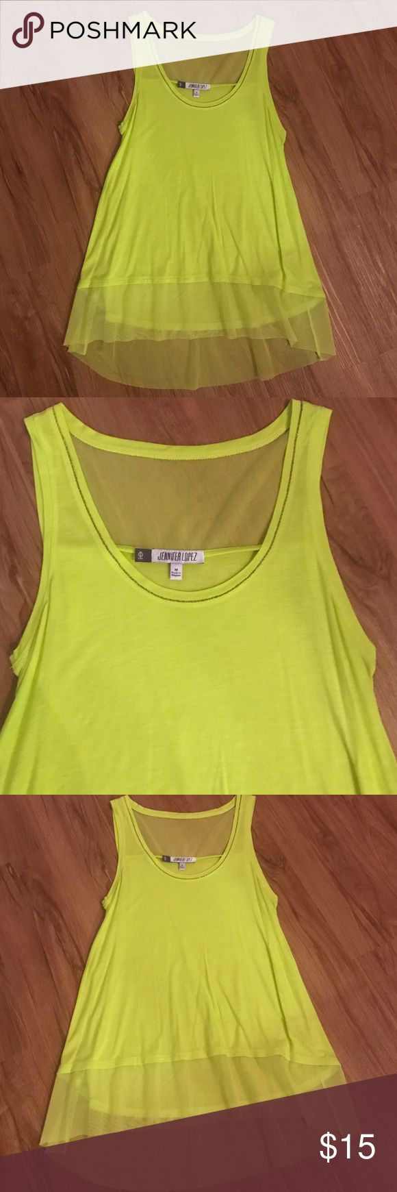 Neon Green Solid and Mesh Tank Top Jennifer Lopez Neon Green Tank Top, never worn! NEW condition. Great for upcoming festival season! Jennifer Lopez Tops Tank Tops