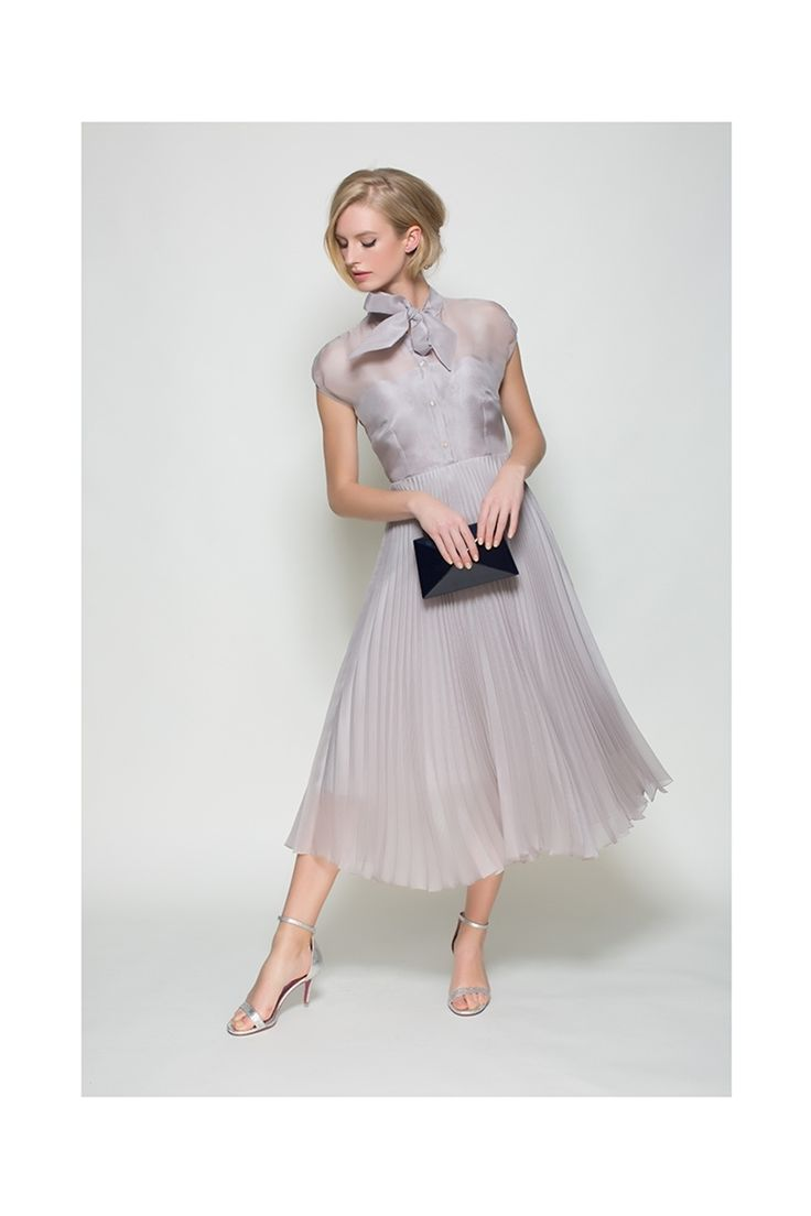 Beautiful silk organza pleat midi length dress. Made to order in bespoke colours including a fit service to determine your ideal length. 1950's inspired very special cocktail dress, which is perfect for any exclusive occasion. The colour of the dress photographed is called 'Argent' which is a sensitive mink tone. x