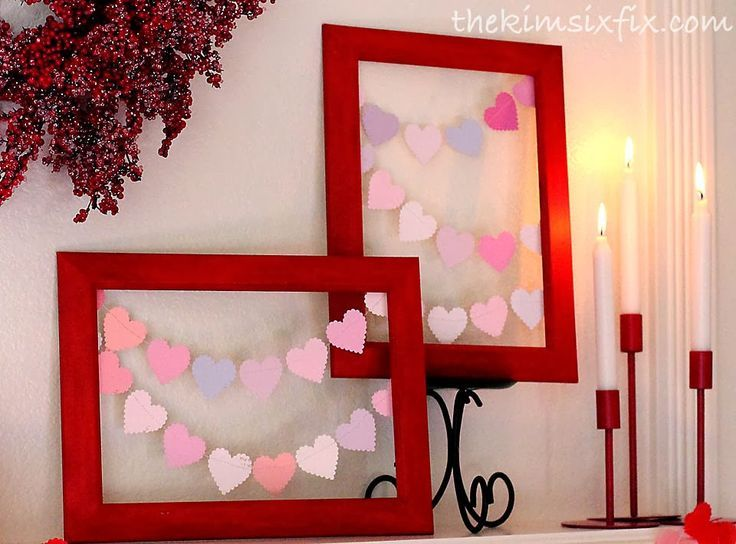 A simple red, white and pink Valentine's Day mantle, featuring thrift store finds and lots of hearts!