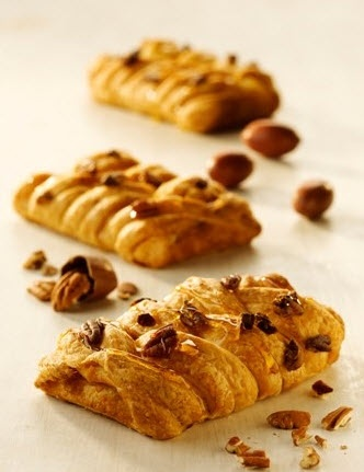 Our Maple Pecan Plait is a  light and flaky Danish pastry  in an appealing braided shape  topped with delicious pecans.  The tasty caramel like filling  is made of aromatic maple  syrup, which is also sprinkled  on top of the baked pastry for  a shiny, golden appearance.