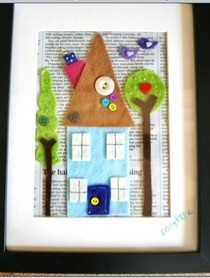 cute felt picture of house & trees with a book-page background