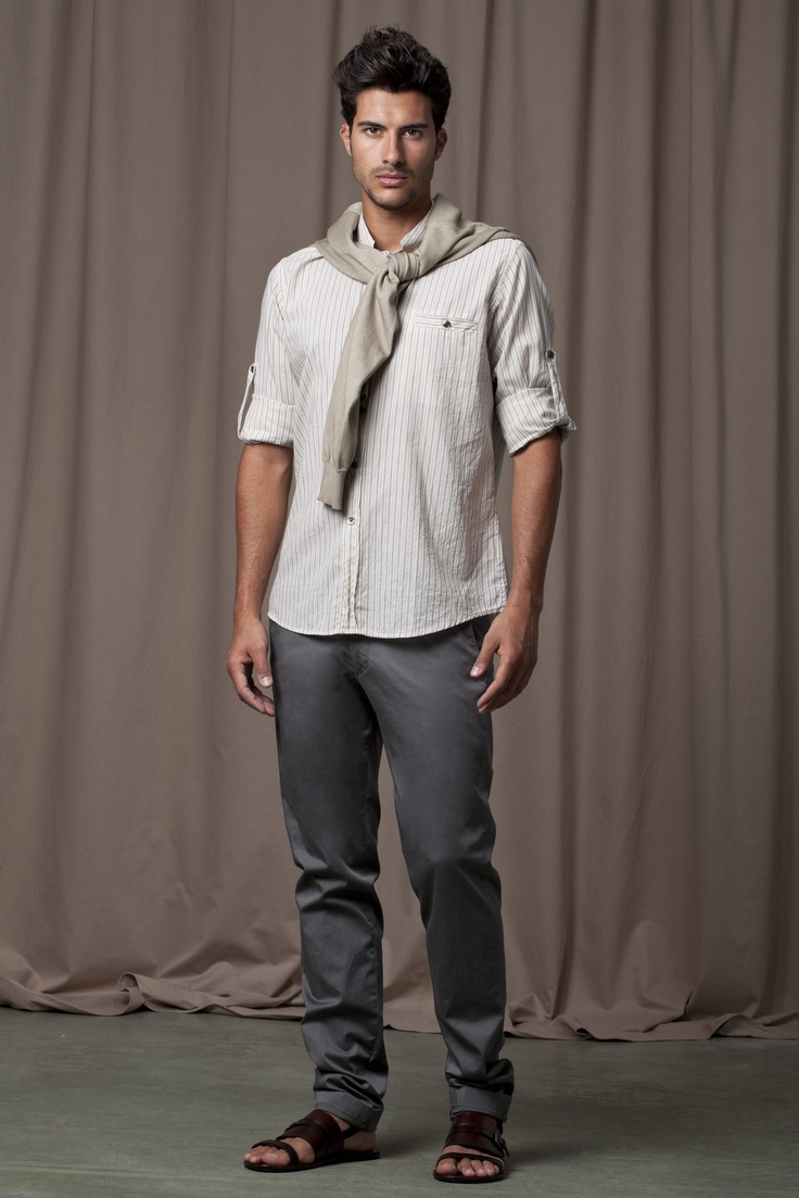 Grey trousers, cream, striped shirt, beige jersey and black, leather sandals