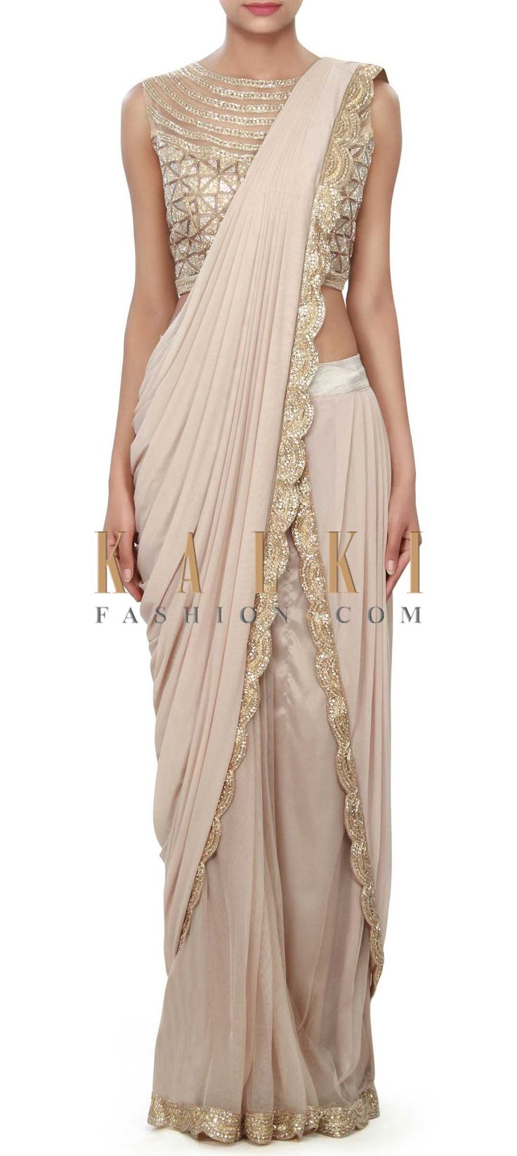 Buy Online from the link below. We ship worldwide (Free Shipping over US$100) Price- $439 Click Anywhere to Tag http://www.kalkifashion.com/brown-saree-gown-adorn-in-cowl-drape-only-on-kalki.html